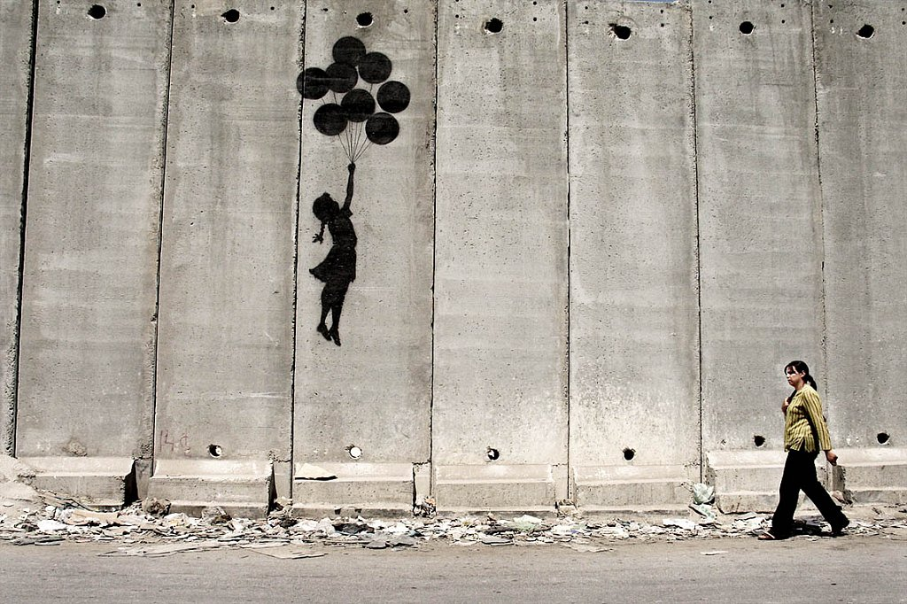 Banksy fresh painting. The separation wall near Ramallah