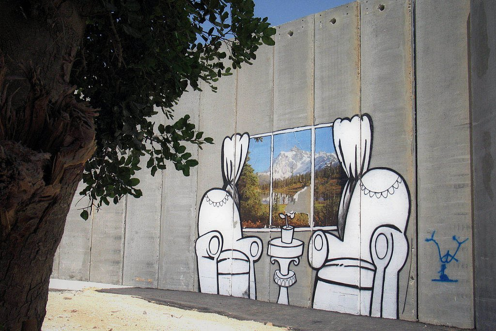 Banksy fresh painting. The separation wall near Bethlehem